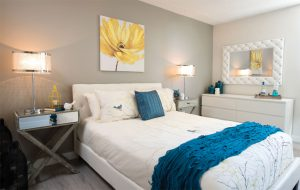 White and grey bedroom with blue highlights